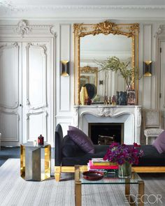 `The living room in a 19th-century Parisian apartment screams glamour with its ornate detailing and gilded accents. The daybed is upholstered in a Lelievre velvet, the 1930s cocktail table was found at the Drouot auction house,and the gilt-wood mirror and marble fireplace are original to the apartment.