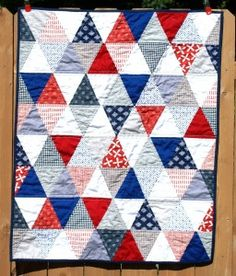 red, white, and blue triangle quilt