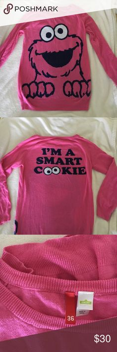 H&M Cookie Monster Sweater Size S Super cute pink sweater from Divided by H&M. It is a Size 36, which is like a US small. Length is 26 inches. Looks super cute with leggings or jeans! Great condition. H&M Sweaters