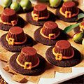 Pilgrim Hat Cookies - Woman's Day. Reese's peanut butter cups, chocolate wafer cookies, orange frosting.