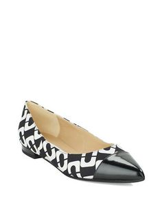 A bold deco print is finished with a classic leather pointed toe for a sophisticated pair of flats.