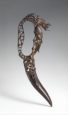 Ceremonial Bichwa Dagger Dated: century Geography: Thanjavur, Tamil Nadu Culture: Indian, Thanjavur Medium: steel, gold Dimensions: overall length inches cm)
