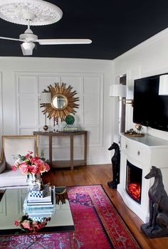 The Home Depot, along with their Home Decorators... Interior living, rug, mirrored coffee table, pair of  greyhound dog statues, gold starburst mirror, lamp, lighting, ceiling molding