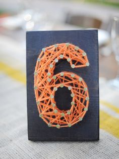 Really want to show your crafty homespun style in your wedding? Use yarn in your wedding details. Most of these ideas are super easy and totally DIY All y Yarn Thread, Wedding Table Numbers, Table Wedding, Wedding Reception, Art For Art Sake, Diy Wedding, Wedding Ideas, Wedding Details, Wedding Stuff