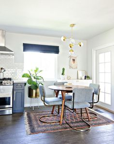 Modern midcentury dining space with pale blue chairs | http://www.popsugar.com/home/Kitchen-Remodel-Tips-37684043?crlt.pid=camp.Hlo2EaKDYIX7&utm_content=buffer7a631&utm_medium=social&utm_source=pinterest.com&utm_campaign=buffer#photo-37684047
