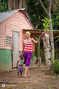 A shot of life in the Dominican Republic - Young mother with her son.
