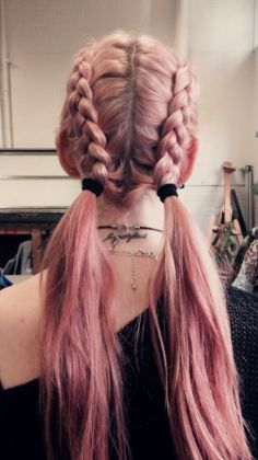 Long pink dyed braided hair with ponytails
