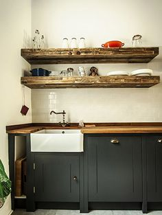 Love the black and white with the rustic oak worktop. If only my kitchen looked this good!