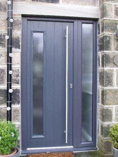 Modern front door and entrance. Door in black. Opaque glass ...