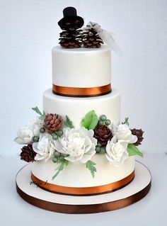 wedding cake with pine cones topper by majalaska - http://cakesdecor.com/cakes/209721-wedding-cake-with-pine-cones-topper