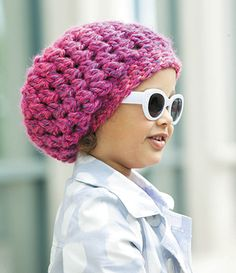 "BUBBLEGUM EPATTERN When wearing this crocheted kid beanie, Bubblegum, people will be muttering, ""Oh, in what movie did that little girl star?"" Cute and fashionable is sure to be a hit! A band helps beanie stay in place. Instructions for sizes small, medium and large are outlined; included are bonus on-line tutorials. Choose super bulky weight yarn and two crochet hooks in Size K (6.5 mm) and Size M/N (10 mm). The suggested skill level to complete this project is rated as ""easy""."