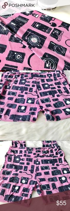 NWT LuLaRoe TC Camera Leggings  LuLaRoe TC Black Cameras  on Pink background! Super hard to find and so cute in person. All items in my boutique are new and sealed in a ziplock bag right after I photograph them. Bought these on Posh and changed mind. Did not try on. Major hard to find! Photos taken with and without flash. Background color is light pink. Price is firm, what I paid for them.  LuLaRoe Pants Leggings