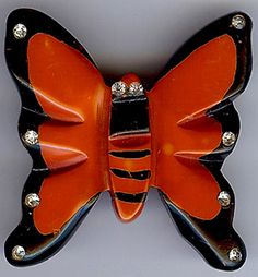"""Vintage Bakelite Pin VINTAGE CARVED OVERDYED PAINTED BAKELITE RHINESTONE BUTTERFLY PIN  Delightful orange Bakelite butterfly pin with rhinestone and black accents measures approximately 2"""" by 2"""". The back is a bright red and the front is a reddish orange."""
