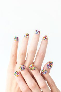 Nail art: A sprinkle manicure tutorial with actual sprinkles. Our kids would flip.  (Yes, you cover it with a top coat.)