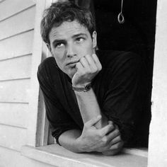 """life:  """" Marlon Brando was born today, April 3, 1924 in Omaha, Nebraska. Pictured here in 1951 leaning out of his parents window. (Art Shay—The LIFE Images Collection/Getty Images) #LIFElegends  """""""