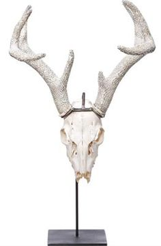 Deer skull with crystal antlers It's a shame what they did to poor Rudolph. Found at: vivre.com Price: $2,500