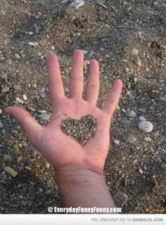 this photography makes you look twice at this image it looks like this person has as heart shape through their hand