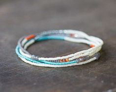 Youll find a super pretty color palette on this beaded multi wrap bracelet. It features Czech seed beads, along with labradorite, black spinel and pyrite. So easy to put on and take off, great also for wear as a necklace or wrapped anklet! I love putting a big stack of them together.... :) This is a delicate piece with tiny seed beads; gemstones measure 2-3mm. Completed piece measures 34 inches, and will typically wrap around the wrist 5 times…