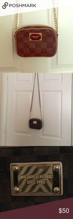 Michael Kors small cross body purse Small cross body bag. Perfect for grabbing the essentials and going so you don't have to carry a large bag around. Some light wear and tear around edges Michael Kors Bags Crossbody Bags