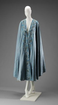 Early 20th century - Opera Coat - Teal opera coat with floral design embroidered at edges. Teal and green tassels at corners.