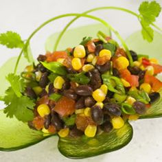Black Bean Salsa low calorie!  cumin, garlic, lime juice, jalapeno, black beans, mexican corn, canned tomatoes with chiles,  cilantro refrigerate 8 hours