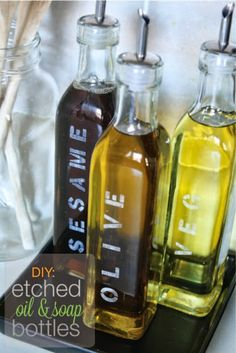 diy etched oil bottles by urbane jane grouped oils on a tray would look nice. spices near by and it'd look like i cook. Glass Engraving, Engraving Ideas, Dremel Projects, Olive Oil Bottles, Glass Etching, Etched Glass, Cooking Oil, Bottle Design, Bottle Crafts