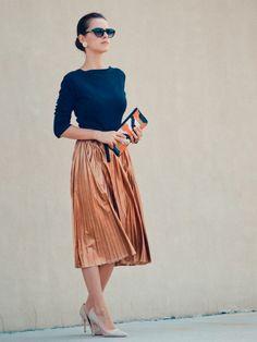 Fall 2012 trends: cat eye sunnies, navy blue sweater, metallic tea length skirt, printed sequined clutch, and nude heels.