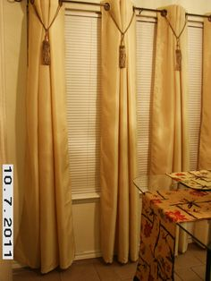 Curtain Makeover: beautiful. Kitchen window view. 4 curtains, with large tassels that hang center of pleats. Even when the curtains are opened, it still has an elegant look.