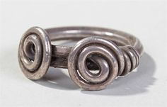 Viking silver finger or toe ring, 800-1000 A.D. wound from a single tapered rod of silver, thicke