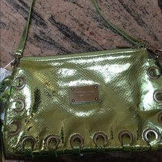 Micheal Kors leather clutch. Micheal Kors green snakeskin clutch, absolutely gorgeous!! Perfect for the summer!! Features two tassels hanging from the side. The color is amazing, shinny green snakeskin!! Michael Kors Bags Clutches & Wristlets