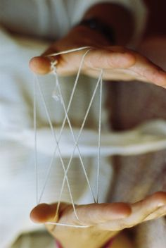 Cats cradle. I used to love this, always wanting my mum to play it with me, she could keep it going for ages
