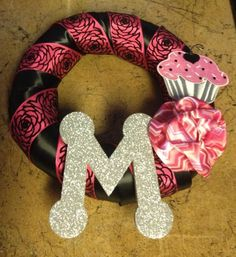 Took a wreath craft and tweaked it for a kids bedroom door. This one is for the babysitters little girl :)