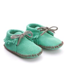 Add a touch of tribal-inspired trendiness to petite feet with these marvelous mini-moccasins. Handcrafted in soft suede, these charming treasures are sure to never pinch or restrict tiny tootsies from wiggling the day away. Both darling and practical, the tie closure keeps everything comfortably in place while little ones wander.