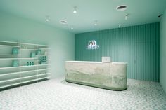Pharmacy app opens Brooklyn waiting room featuring calming turquoise tones