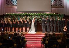 We're loving this amazing greenery wall set up at the altar! Photo by Randy Coleman & Carli Photography. #wedding #altar #greenery