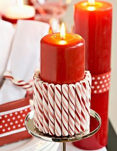 candy cane candles are perfect for a red and white christmas theme. Plus, it's super easy to make! just glue candy cane sticks with a hot glue gun with a red (or white!) colored candle.