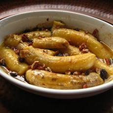 Cuban Banana Casserole with bananas, light brown sugar, unsalted butter, chopped pecans, raisins, brandy.