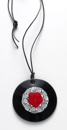 Murano Disc Necklace--Handmade from kiln-fired and fused Murano glass, our disk necklace amplifies the passion of this coveted art form.