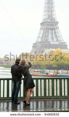 Couple in Paris at rainy weather - stock photo