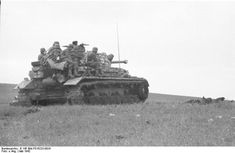 German soldiers on PzKpfw IV during campaign on Crimea. May 1942