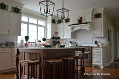 Christmas Kitchen - white kitchen with red and green
