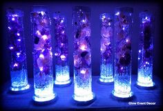 cylinder vase with purple orchids wedding table centrepieces, with submersible LED lighting and LED light base