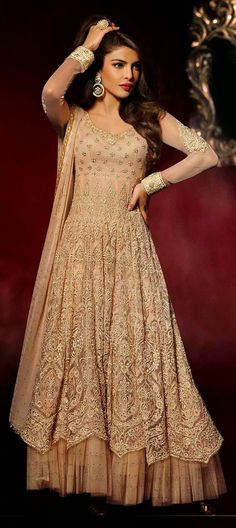425501: Beige and Brown color family unstitched Bollywood Salwar Kameez.