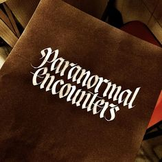"""""""Paranormal encounters. White Sumi ink on black handmade paper. #sachinspiration #calligraphy #instatype #instadaily #thedailytype #typegang #typedaily…"""""""