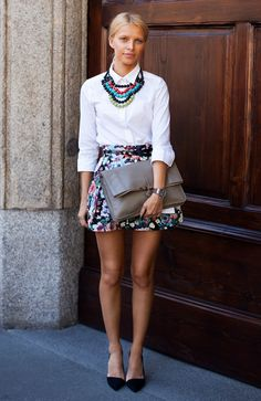 OUTFIT: | COLORFUL Mini or MAXI PATTERNED Skirt + SOLID Crisp WHITE Button-Down Blouse (Tucked) + Small Colorful Statement Necklace in colors that MATCH to your Skirt + Pull Hair Back into Sleek Bun, WEAR with a Neutral Purse, and Super-Natural Makeup in Nudes and Soft Pinks.