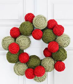 Spin yarn into a wreath with pop appeal. To craft this door adornment, wrap Styrofoam balls (in two different sizes) and a Styrofoam wreath form with colored yarn. Then use a glue gun to affix the balls onto the form, as shown. Note: If you're hanging your final creation outdoors, be sure to spray it with a protective finish. - CountryLiving.com