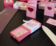 Decorated with patterned papers, ribbon, and other small embellishments, tiny boxes manage to hold a lot of love.