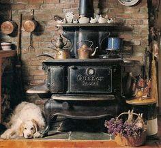 I like the rock  floor beneath and brick wall behind the stove. Good time Stove Company, Massachusetts