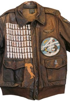 An A-2 jacket worn by an American air gunner in the 86th Bomb Squadron, 47th Bomb Group. The dog was the squadron mascot, and the outline of Italy indicates were he served.