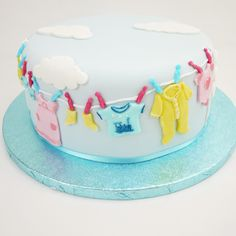 Baby clothes washing line cake - great for a new born baby, baby shower or Christening